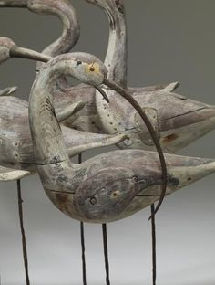 Eight Old Curlews by Guy Taplin driftwood carvings embellished with glass eyes  rusted metal
