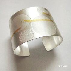 Handmade silver modern bangle perfect for any occasion!  Feel free to email us with any requests at kanini.jewelry@gmail.com. We look forward to hearing from you!