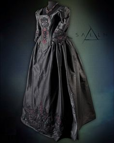 Mary Sibley black taffeta dress with black and red hand embroidered beading.  Season 2.