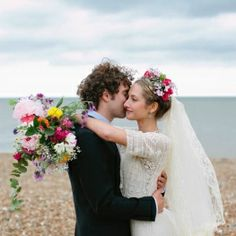 I wish this picture was bigger! Her dress and flowers are so pretty!
