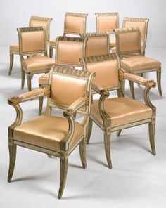 Set of ten Italian, neo-classical, cream painted and parcel gilt dining chairs: Circa 1780, two side chairs of a later date.