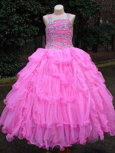 Beautiful Unique Fashion Pageant Dress UF1080F. This floor length pageant dress has a tank style, fitted and beaded bodice, and a layered ball gown skirt. This adorable dress will make your little pageant girl a star. Available in Neon Pink and Royal Blue.