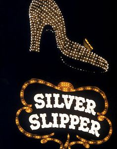 """The Silver Slipper, Las Vegas - operated from September 1950 to November 29, 1988, starting out as the Golden Slipper, and changing to the Silver Slipper. In 1988 the building was imploded to make room for a parking lot. The """"Slipper"""" can still be seen in old downtown Las Vegas."""