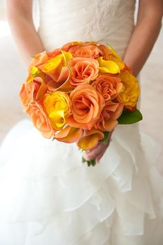 Pineapple and papaya colored bouquet | Photo by Donna Von Bruening