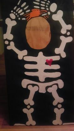 Photo board for Halloween carnival. Ply wood with face cut out, easy skeleton drawing. Paint. Lots of funny pictures will be taken with this prop.