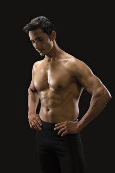 Close-up of a muscular man standing with his hands on his waist Man Standing, Muscular Men, Male Body, Physical Fitness, Physique, Health Fitness, Hands, India, Sexy