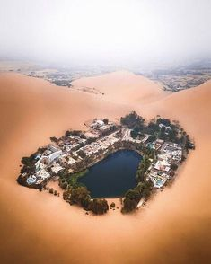 Oasis town of Huacachina, Peru. Desert Oasis, Desert Life, Machu Picchu, Huacachina Peru, Voyager C'est Vivre, Destinations, Destination Voyage, The Dunes, Aerial Photography