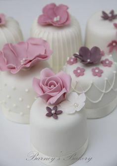 Mini white icing wedding cakes