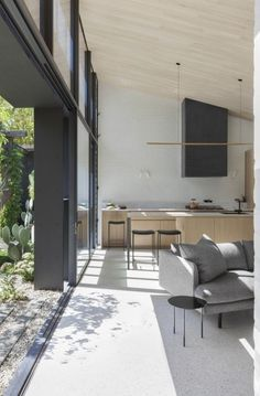 ANGLED CEILING WITH CLADDING, LIGHT OVER KITCHEN- Baffle House | Clare Cousins Architects