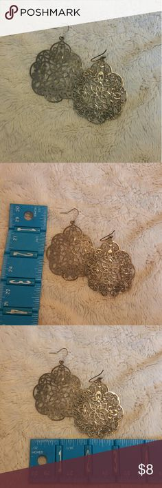 Silver floral earrings Light silver earrings with intricate floral design. Photographed with a ruler to show size.   *all jewelry pieces have been cleaned with a mixture of jewelry cleaner, water, and rubbing alcohol and will come in a jewelry pouch* Jewelry Earrings