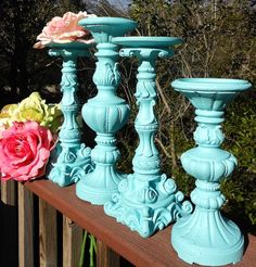 Candle holders- could easily take a hodge podge collection of these and paint them the same color to have a set!