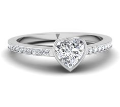 Bezel Set Heart Shaped Engagement Ring with 1/3 cttw in SI1-2 H Diamonds (center stone not included-free CZ provided) Can be made to fit any size heart shaped center stone and can be crafted in white