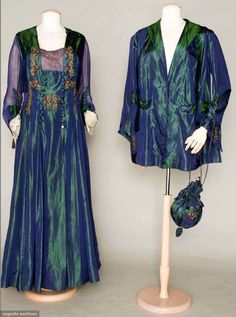 Blue-green changeant silk taffeta tea gown with embroidered appliqués and navy blue chiffon sleeves and modesty panel, with matching jacket and purse, c. 1915.