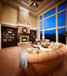 Great room with coffered ceilings and large windows with a view.