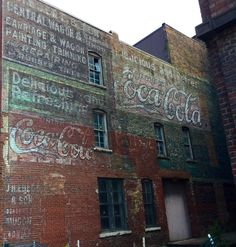 https://flic.kr/p/JB1ahp | Coca Cola painted signs, Burlington, Iowa | Coca Cola signs on a building in downtown Burlington, Iowa. A wagon repair sign can also be seen. The signs were once covered by another building.