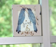 A square of interesting fabric stapled/stretched around a wooden frame to make an easy & interesting piece of art  :)
