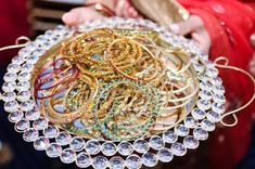 """Hand out bangles to collect if someone says """"baby"""" twist on a traditional game.  Winner gets to keep bangles"""