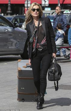 First class departure! Kate Moss was seen leaving her hotel in Paris as she made her way t...