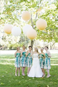 the prettiest bridesmaids ever! Modcloth watercolor bridesmaids dresses with oversized balloons. Captured By: Angie Silvy ---> http://www.weddingchicks.com/2014/05/08/fill-your-wedding-with-love-and-adventure/
