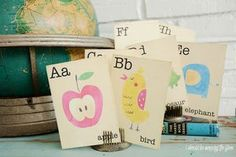 Vintage alphabet flash cards by a globe