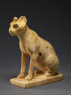 Cosmetic Jar in the Form of a Cat, Middle Kingdom, Dynasty 12, ca. 1991–1783 b.c. Egyptian Egyptian alabaster (calcite) with inlaid eyes of rock crystal and copper