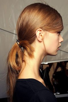 Spring/Summer 2013: Easy Does It - Models wore their hair in looped ponytails, simply tucked into the ends of a black elastic.
