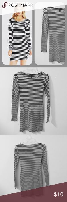 """Long Sleeve Body Con Dress This long sleeve striped navy and white body con dress by Forever 21 is a closet staple. Stripes are trending in 2017. This dress is very stylish and perfect for areas where the weather is still cold. The material is a heavier fabric 92% Rayon 8% Spandex 30"""" Top to bottom Phot is not the actual dress but very similar to fit and style Forever 21 Dresses Long Sleeve"""
