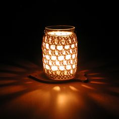 Crocheted jar cover to hold a candle...beautiful gift idea.