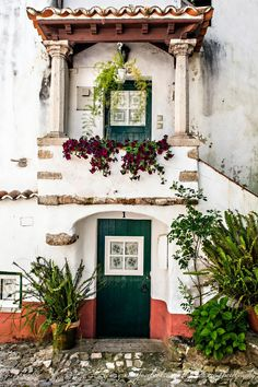 Óbidos fortified village, Portugal this is just beautiful. One day ill live in a house like this.