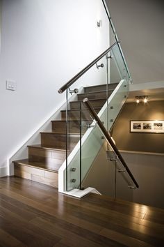 Made Maple Stair with Glass Railing and Stainless Steel Handrail and Stand Offs by Prestige Railings & Stairs Inc. / Rise And Run Inc. Glass Handrail, Glass Railing System, Metal Stair Railing, Staircase Handrail, Stair Railing Design, Glass Stairs, Glass Balustrade, Staircases, Banisters