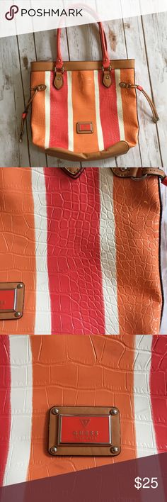 """Guess Tattler Tangerine Multi Purse Orange Pink Has a very slight mark on the front. Hard to see, though (second pic). No cracks or flaws in straps Guess patent leather outer. Carry-on with the double strap along with top zip closure. Guess logo on the front bag with Silver stud & ring hardware. Interior: 1 zip pocket and 3 slip pockets. Rose Print cloth interior Snap closure Three section inside. Middle one zips. Outer sections have pockets.  """"Reptile"""" Textured like a faux snake skin…"""
