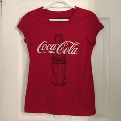 "Coca-Cola Shirt Red short sleeve Coke tee. Junior Large  No Trades  ✅Bundle Discount  ✅Custom Bundles  ✅Free Gift with Purchase over $8.00  ✅Fast Shipping  ✳️Please use the ""Offer"" button instead of trying to negotiate in the comments. Thank you  Tops Tees - Short Sleeve"