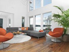 Living room with orange and greay colour palette / Olohuone, jossa oranssi-harmaa värimaailma