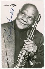 Sidney Bechet, Clarinetist and soprano saxophonist and pioneer of New Orleans jazz was born on this day in 1897. Along with Armstrong, Jelly Roll Morton and Joe 'King' Oliver, began his career in the red light district of Storyville in New Orleans. Trhoughout his career, he played with all of the great players including Duke Ellington. Later in life he settled in France until his death on his birthday in 1959 at the age of 62. http://neworleansradio.com/today-in-music-history/