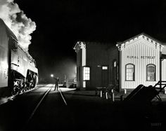 Station agent J.L. Akers waves on an eastbound Norfolk and Western passenger train as it leaves Rural Retreat, VA December 24, 1957