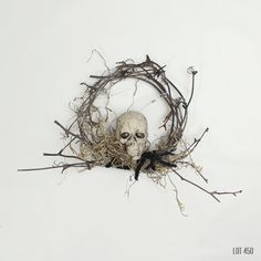 Halloween wreath in a gothic, pirate theme. Moss and black twine wrapped on a grey, aged grapevine wreath. With a faux, plastic human skull.  Outside edge, about 5 in diameter Plastic, fake human skull Aged, grey grapevine Gothic Halloween, Pirate style  See the 10 coordinating wreath: www.etsy.com/listing/469667999