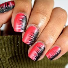 Make heads turn showing off this fiercely spiked coral red, black and lilac nail art. Draw inspiration from this video tutorial to DIY this awesome manicure.