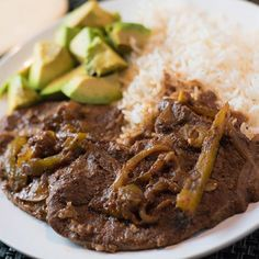 "Bistec en Cazuela translates to ""Steak in a Pan"" and is a traditional Cuban recipe that uses palomilla steak and lots of sauce."