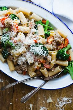 Rigatoni with Sweet Italian Sausage, Grape Tomatoes, and Broccoli  by Alina Munoz, buzzfeed: Healthy and filling. #Pasta #Broccoli #Sausage