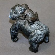 """Barry Stein bronze Silverback Gorilla Mama & Baby. An African wildlife animal sculpture in black. The fine detail depicts the layers of her hairy coat as she poses in an arched position on all fours. Her baby riding on her back, holds on tightly, so as not to fall. Ltd. Ed. 1000 with certificate of authenticity, approximately 6.0""""l x 6.0 """"h."""