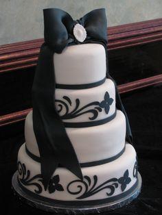 Black and white wedding cake w/fondant bow