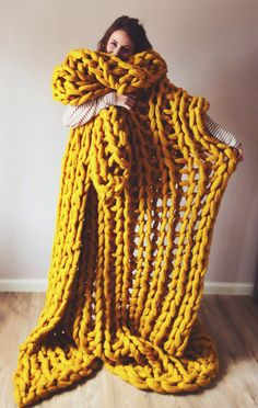 "Oh knit, this is big: Giant knitting is taking the fiber world by storm with super-sized cozy blankets and scarves (saves for ""giant knitting"" +200%). This one has been very popular! Everyone wants to roll up in it like a giant sausage roll! Super chunky knit blanket by Lauren Aston Designs - Large Yarnscome throw in Mustard yellow... So cosy!"