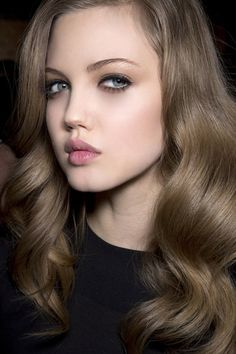 Gorgeous blowdried voluminous hair; pale pink lip and smokey eye