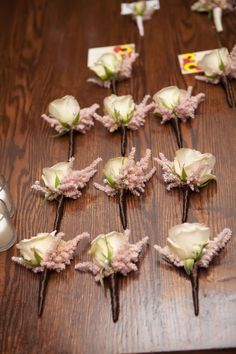 The rest of the boutonnieres will be blush pink spray roses and blush pink astilbe wrapped in thin purple ribbon with the stems showing.