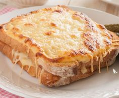 Béchamel, like bacon, makes everything better. So it's no wonder that the sandwich of ham and cheese smothered in béchamel sauce that the French call a Croque Monsieur is so damn delicious. Croque Mr, Toast Hawaii, Queso Mozzarella, Good Food, Yummy Food, Wrap Sandwiches, Sandwich Recipes, Breakfast Recipes, Foodies