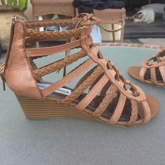 Steve Madden BoHo lace up sandals Tan Bo Ho lace up sandals zips up back. in good condition wedge heel 2 inches . Slight discoloring at Toe area not really seen when wearing. Not in new condition - but Have a lot of life left ! Steve Madden Shoes Sandals