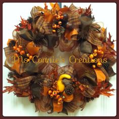 Fall deco mesh wreath with plaid ribbon, fall orange and fall brown. Fall leaves, pine cones, berries, and acorns. Available on Etsy @ Creations by Ms Connie or Ms Connie's creations on Facebook. $70.00
