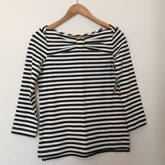 HPKate Spade Top Kate Spade 3/4 sleeve stripped top. Has black and white stripes, sides have mini slits, one side has little gold spade charm accent, front has bow look at top. Super cute! kate spade Tops