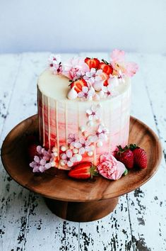 "If you're really looking to jazz a cake up, flowers are the way to go, especially if the cherry blossoms are blooming in your area. They're just so darn pretty and they take a cake from ""Yeah, pretty cool"" to ""Amazing…""."