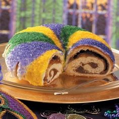 purple-green-gold king cake.  Whoever finds the baby - has the next king cake party.